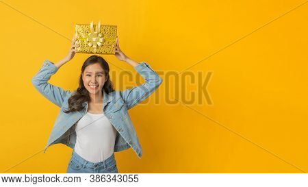Panoramic Wide Banner. Happy Asian Pretty Woman In Casual Clothing Smiling And Hold New Year Gift Bo