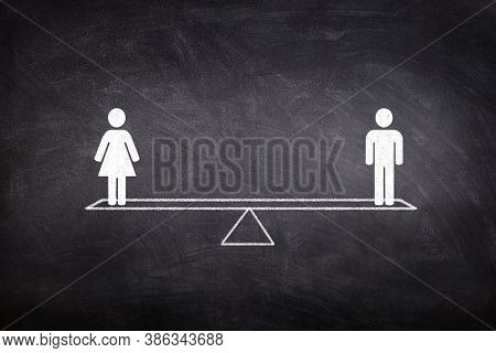 Gender Equality Concept : Male And Female Figure Icon Symbols Balancing On Seesaw Or Balance Scales