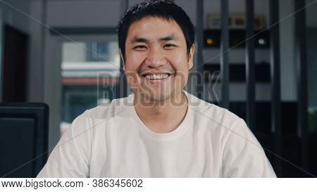 Portrait Asian Chinese Man Feeling Happy Funny At Home. Young Male Relax Toothy Smile Looking To Cam