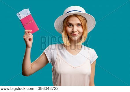 Holiday Trip. Travel Agency. Happy Woman In White Holding Foreign Passport With Tickets. Looking At