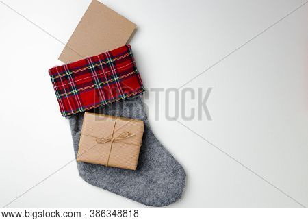 Christmas Stocking With Wrapped Gift On White Background