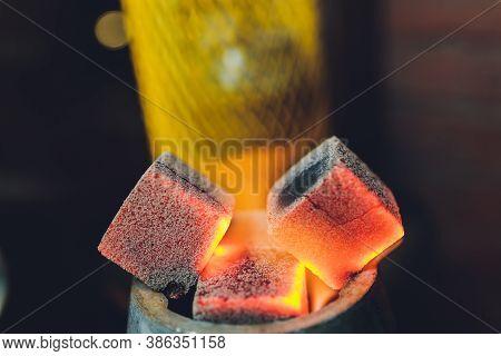 Coals For Hookah Close-up. Burning Coals On The Hookah Bowl.