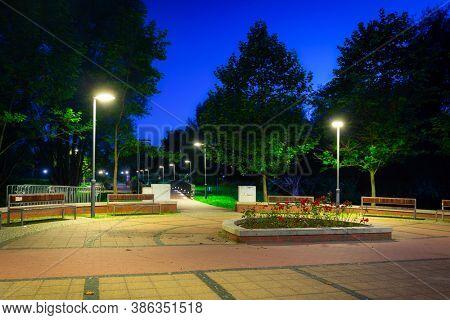 Scenery of the park in Pruszcz Gdanski at night, Poland.