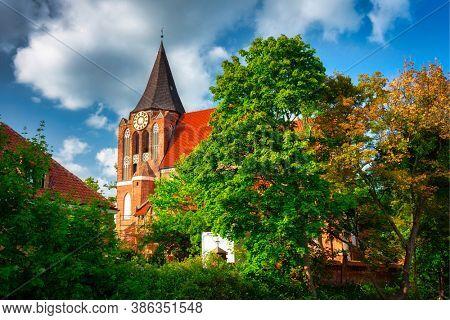 Beautiful brick church in Pruszcz Gdanski in summer scenery, Poland