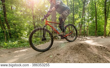 Bicycle with cyclist in sunlights