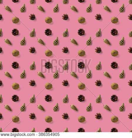Seamless Christmas Pattern From Pine Cones On Pink Background. Modern Pine Cone Christmas Collage. P