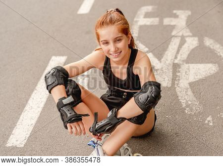 Young girl in rollerblades on bicycle lane