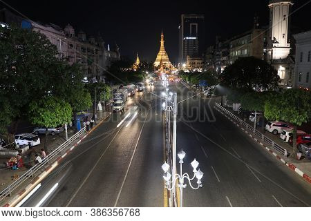 Yangon, Myanmar Feb 21, 2019: Night Time And Speed Of Light At Golden Octagon Of Sule Pagoda Located