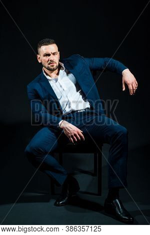 Handsome Young Business Man In A Studio Wearing A Suit. Fashionable European Businessman In Perfect