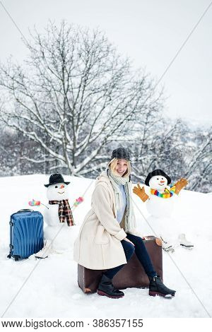 Planning Winter Vacations. Winter Holiday. Happy Smiling Snow Man And Winter Girl On Sunny Winter Da