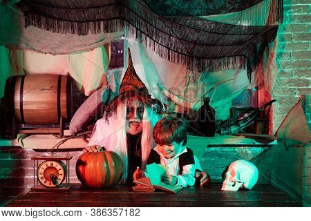 Happy Family Celebrating For Halloween. Father And Son Has Fun In Halloween Time. A Terrible Night O
