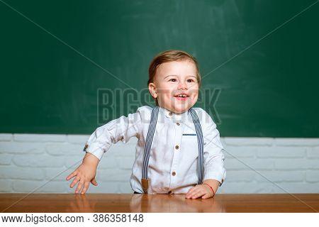 Schoolkid Or Preschooler Learn. Elementary School. Cute Preschooler With Funny Face Schooling Work.