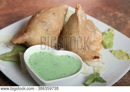 Traditional Indian Or Pakistani Ramadan Food, Samosa With Green Sauce, Ramzan Iftar Food, Spicy Stre