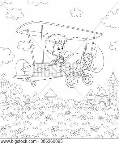 Little Cheerful Boy Piloting His Small Toy Plane Among Clouds In Summer Sky Over A Park Near Cute To