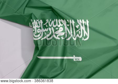 Saudi Arabia Fabric Flag Crepe And Crease With White Space, A Green Field With The Shahada Or Muslim
