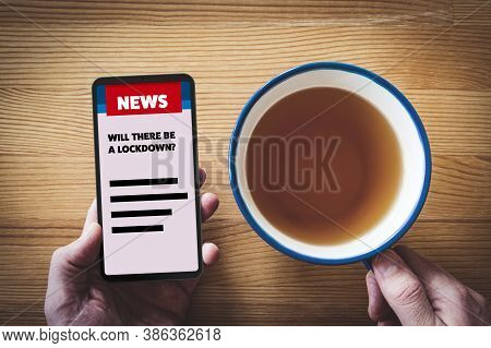 Will There Be A Lockdown? Person Read News On Smartphone About Lockdown In Covid Epidemic Times Conc