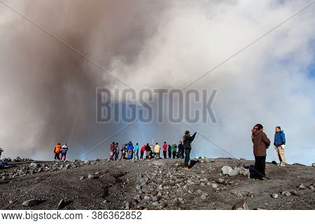 Semeru, Java/indonesia - May 4, 2015: Ash Cloud Above Climbers At Semeru Volcano Summit. Version 2.