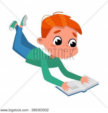 Cute Boy Reading Book While Lying On His Stomach On Floor, Preschooler Kid Or Elementary School Stud