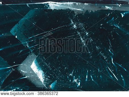 Cracked Ice Background. Frozen Water Surface. Teal Blue Scratched Abstract Texture With Frost.
