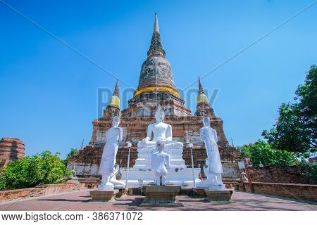 White Buddha And Chedi At Wat Yai Chai Mongkol, Ayutthaya Province, Thailand