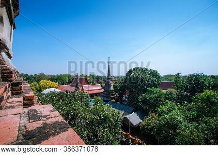 Tree View With Thai Style Houses And Old Pagodas At Wat Yai Chai Mongkhon, Phra Nakhon Si Ayutthaya