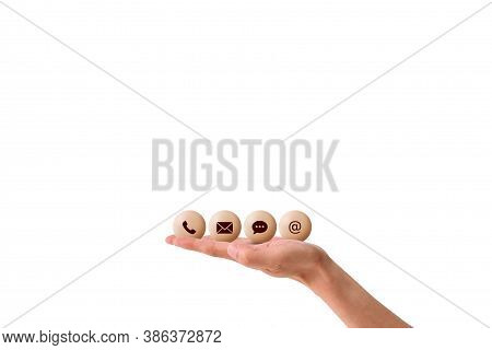 Call Center And Contact Us Concept : Hand Holding And Showing Contact Us Icon Symbols With White Bac