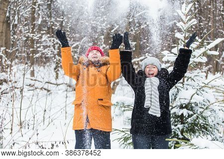 Love, Season, Friendship And People Concept - Happy Young Man And Woman Having Fun And Playing With