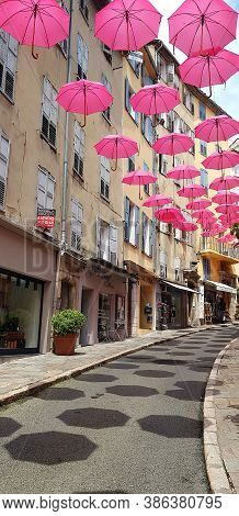 Grasse, France - 21 July, 2020: Pink Umbrellas Hanging In The City Center. The Limited Edition Exhib