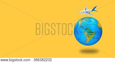 Plastic Toy Plane On The Globe. Flight Travel Concept. Travel By Airplane. Takeoff And Landing Of Th