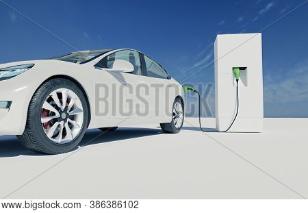 White Electric Car Charges At A Charging Station, Zero Emissions, Alternative Transport, Charging In