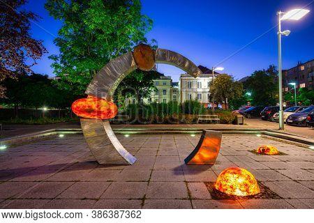 Pruszcz Gdanski, Poland - September 20, 2020:  Illuminated amber sculpture in Pruszcz Gda?ski at dusk, Pomerania. Poland