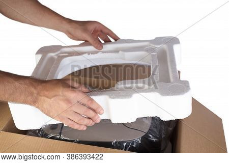 Packing Goods In Cardboard Box With Styrofoam Material For Safe Transportation Of Cargo. Isolated On