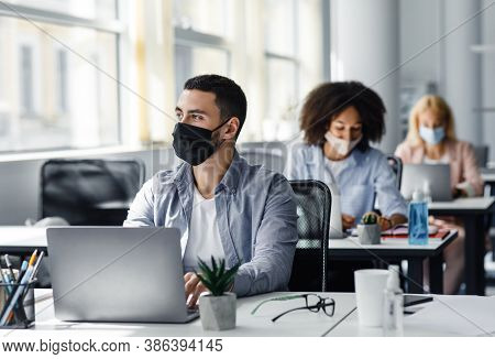 New Rules For Working In Office And Create A New Idea. Arabian Guy In Protective Mask Looks Out The