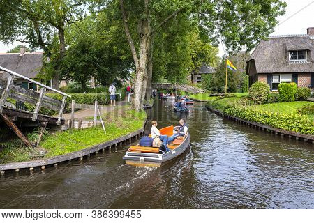 Giethoorn, Netherlands - 13 September 2020. Tourists Sailing On Rented Boats On The Canal Between Ho