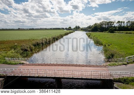 The Groningen Landscape At Aduarderzijl And The Aduarderdiep A Canal Through The Flat Country In The