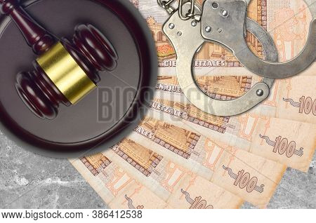 100 Guatemalan Quetzales Bills And Judge Hammer With Police Handcuffs On Court Desk. Concept Of Judi