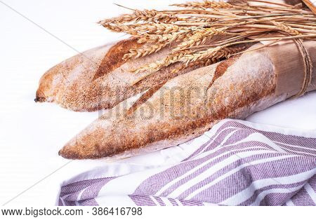 Freshly Baked Baguettes Isolated On White Background.