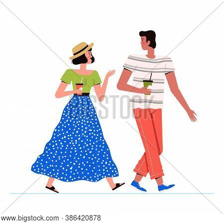 Young Man And Woman Are Walking Together. The Couple Is Walking, Drinking Coffee And Talking. Stylis