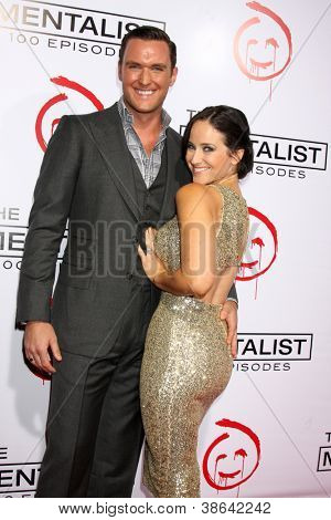 """LOS ANGELES - OCT 11:  Owain Yeoman, Gigi Yallouz arrives at """"The Mentalist"""" 100th Episode Party at The Edison on October 11, 2012 in Los Angeles, CA"""