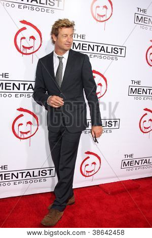 """LOS ANGELES - OCT 11:  Simon Baker arrives at """"The Mentalist"""" 100th Episode Party at The Edison on October 11, 2012 in Los Angeles, CA"""
