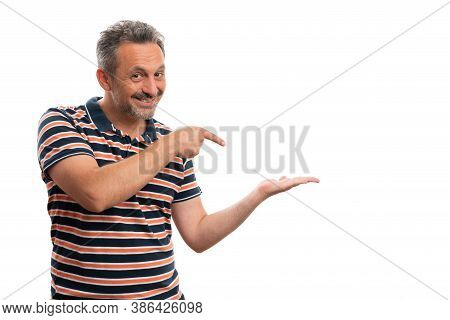 Trustworthy White Adult Male Wearing Stylish Casual Summer Striped Tshirt Pointing Index Finger At B