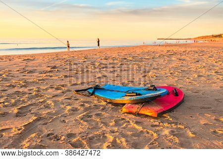 Swimming Bodyboards On The Sand At Sunset, Christies Beach, South Australia