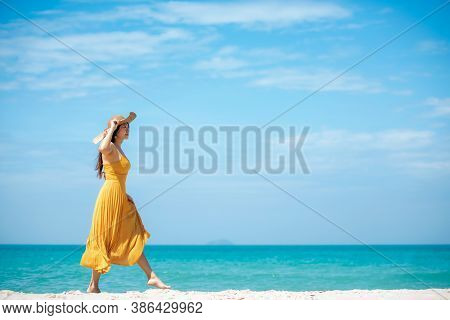 Summer Vacations. Lifestyle Woman Relax And Chill On Beach Background.  Asia Happy Young People Wear