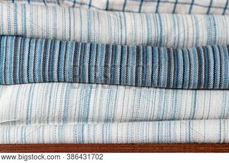Close-up Of White And Blue Pattern Cotton Fabric Texture On Shelf In Natural Fabric Shop