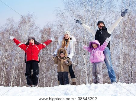 Happy family warking at winter park