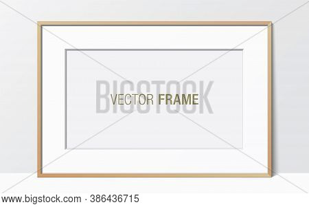 Wide Wooden Frame With Passe-partout Leaning Against The White Wall. Horizontal Blank Elegant Frame