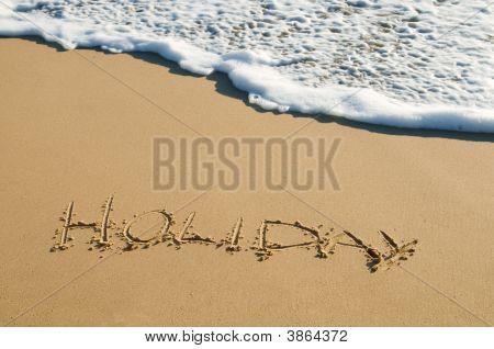 Holiday Written On Sand