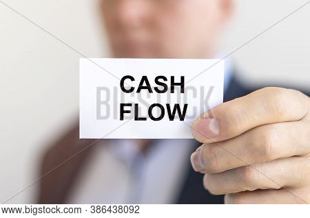 Text Cash Flow Inscription On Paper Card In Hands Of Businessman.