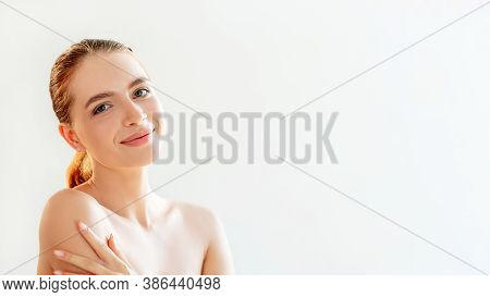 Skincare Treatment. Natural Beauty. Portrait Of Happy Woman With Nude Makeup Touching Bare Shoulders