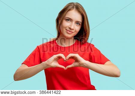 Compassion Sign. Love Care. Portrait Of Supportive Cheerful Woman In Red T-shirt Showing Heart Gestu